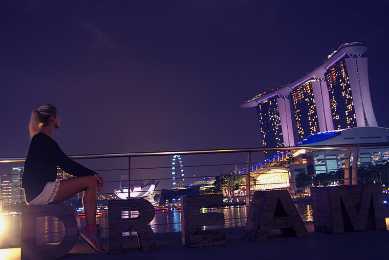 enjoying some peaceful evening hours at marina bay harbor in Singapore