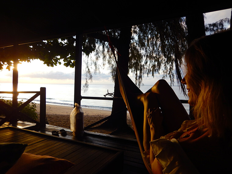 watching the sunset from my bungalow right at the beach in Malaysia on Tioman island