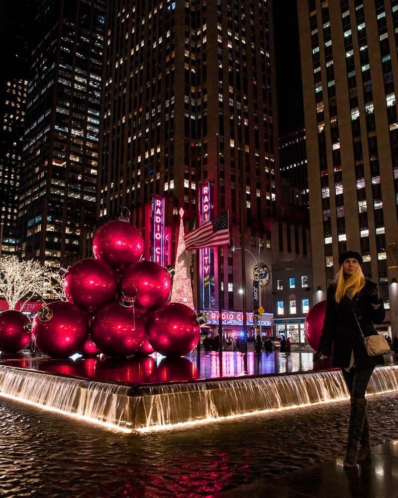 dancing between giant Christmas balls in front of radio city music hall