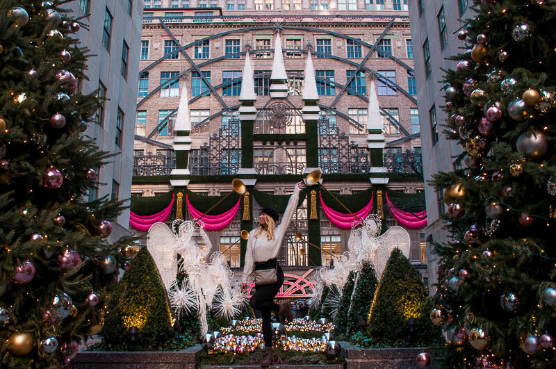 Christmas decorations at Saks in New York facing the Rockefeller center and the Rockefeller tree