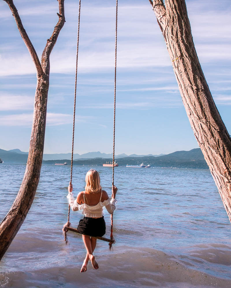 kitsilano is not as touristy and you can find a beautiful secluded beach with a swing